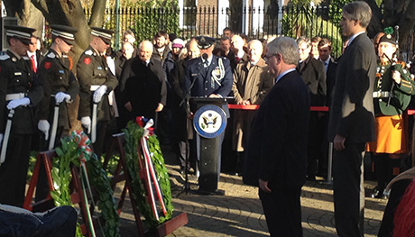 Tánaiste and US Chargé d'Affaires Stuart Dwyer laying wreaths at the US Embassy on the 50th Anniversary of the death of President Kennedy