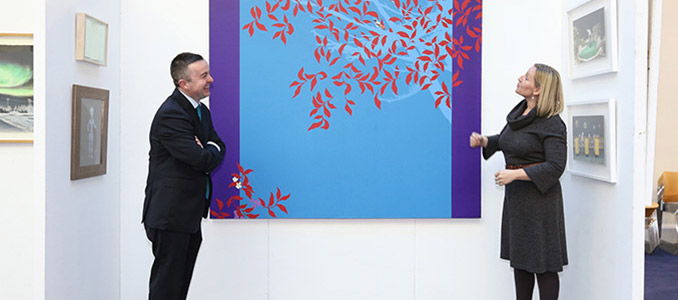 Minister Hayes and Minister Creighton viewing some of the art work before the exhibition began its tour.
