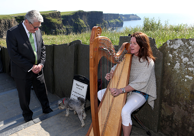 State Visit 2015 H.E. Mr Joachim Gauck  listening to Tina Mulrooney and her dog Jessie at the Cliffs of Moher, Co Clare